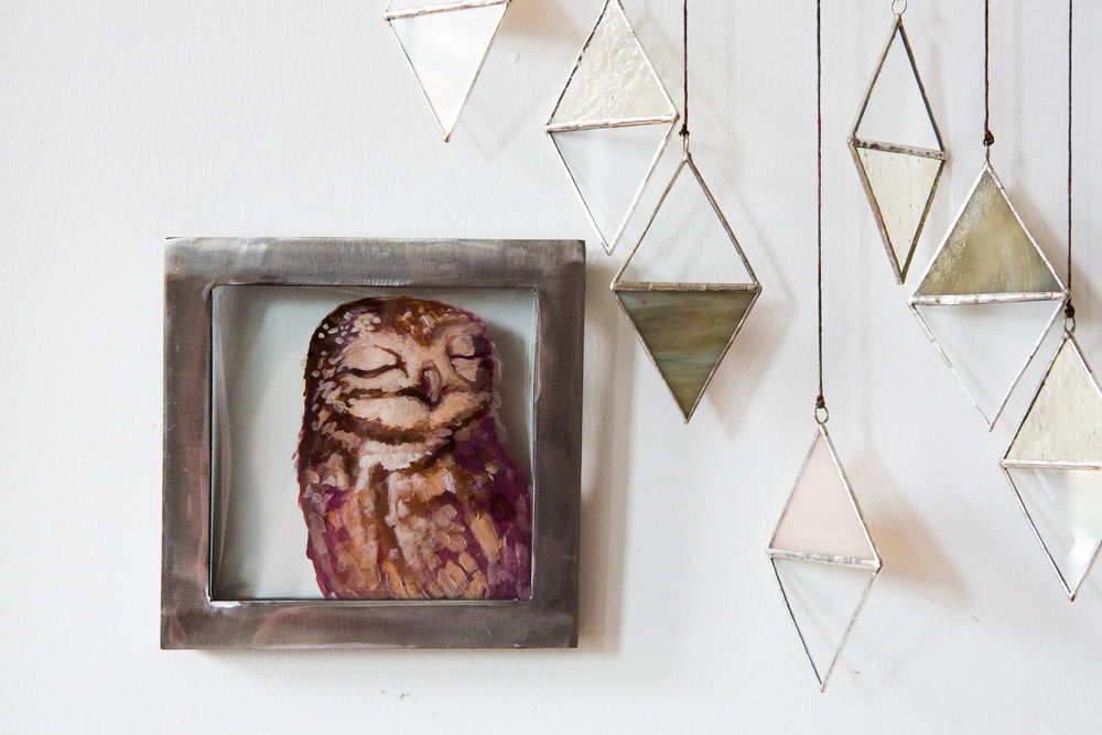 Little Owl  6 x 6 Painting on glass sealed with Epoxy in brushed steel frame.   photo by Joanna Chattman