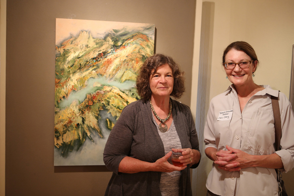 "Janice Pluma, (left) and her acrylic painting, ""Vista"".  Christine Obers (right), Director, Yosemite Renaissance."