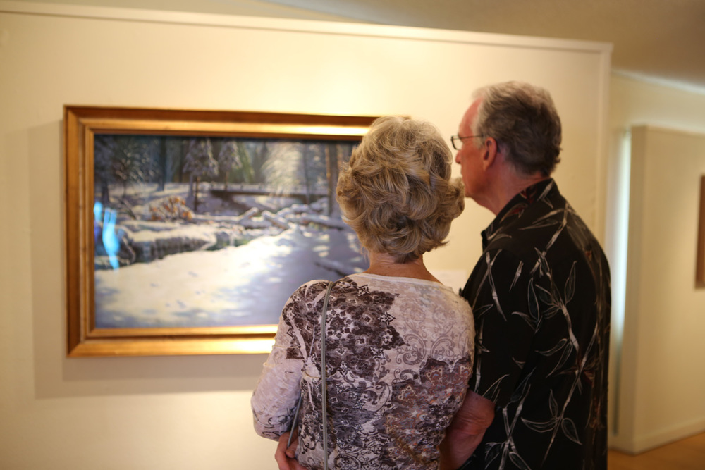 "Visitors admire the pastel artwork, ""Winter Wonderland"" by artist David Will"