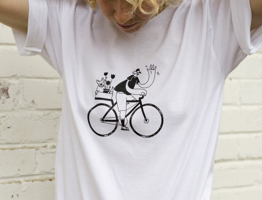 Woman wearing a t-shirt with a character riding a bike
