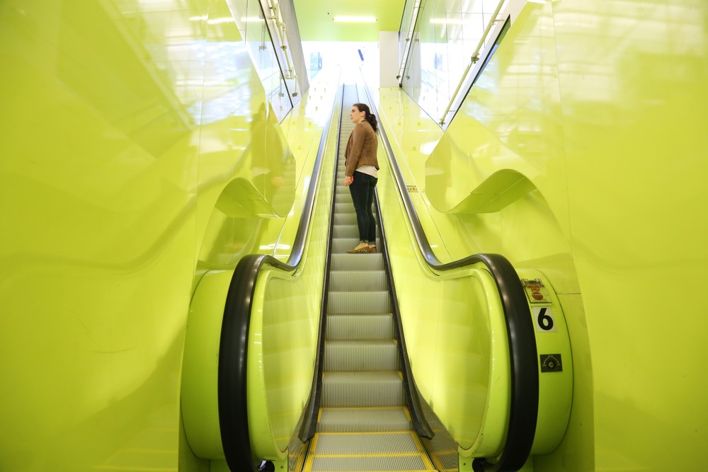 We love the neon yellow escalator.