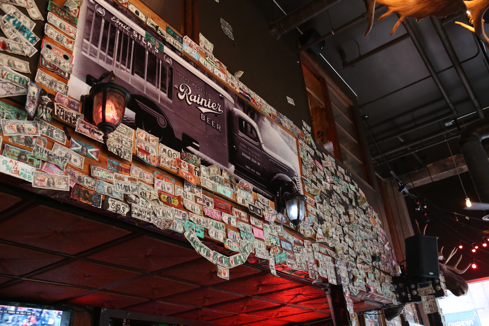 The sign of any good dive bar is dolla dolla bills as decorations.