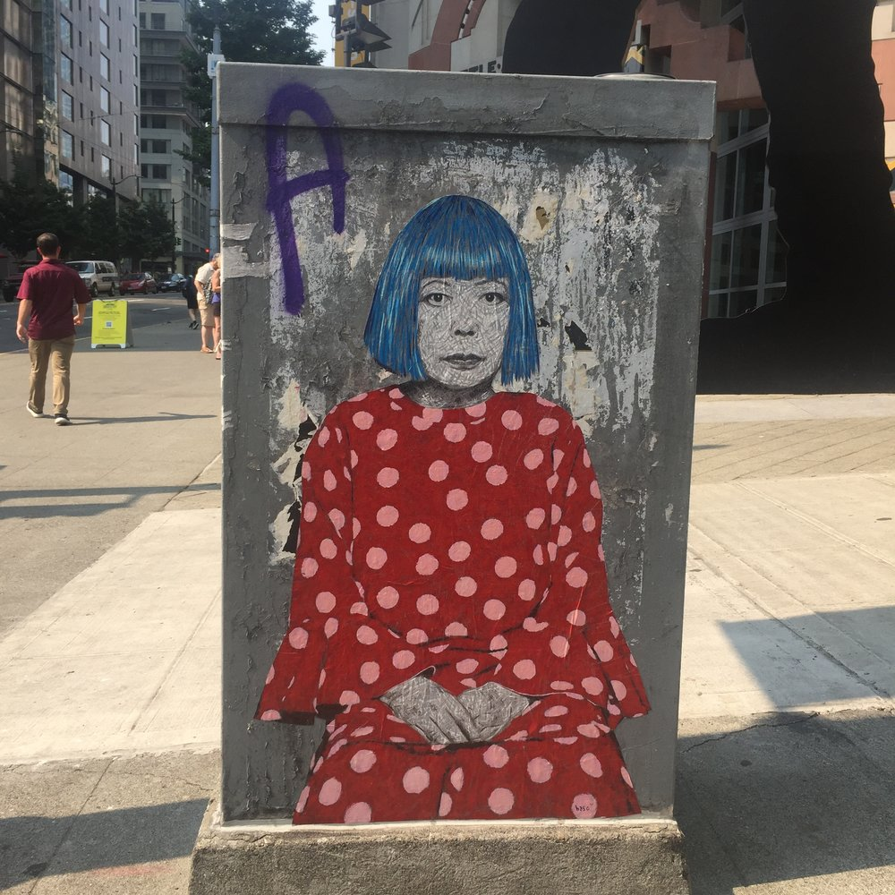 An image of the artist, Yayoi Kusama, painted outside of the SAM