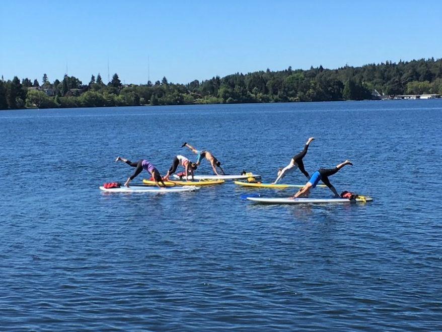 Yoga on the lake! Photo courtesy of SUP Yoga Seattle.
