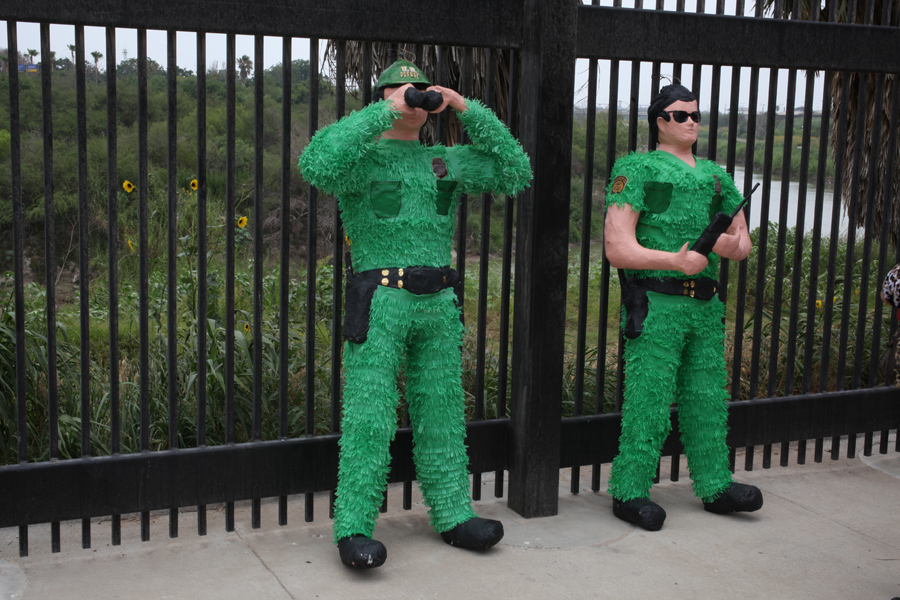 Border Patrol Agent Piñatas by the Mexico / U.S.A border wall   2011