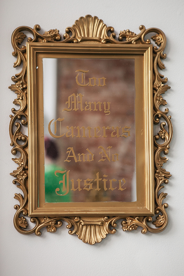 """Too Many Cameras and No Justice (Small Mirror)""   19 1/2"" x 14"""
