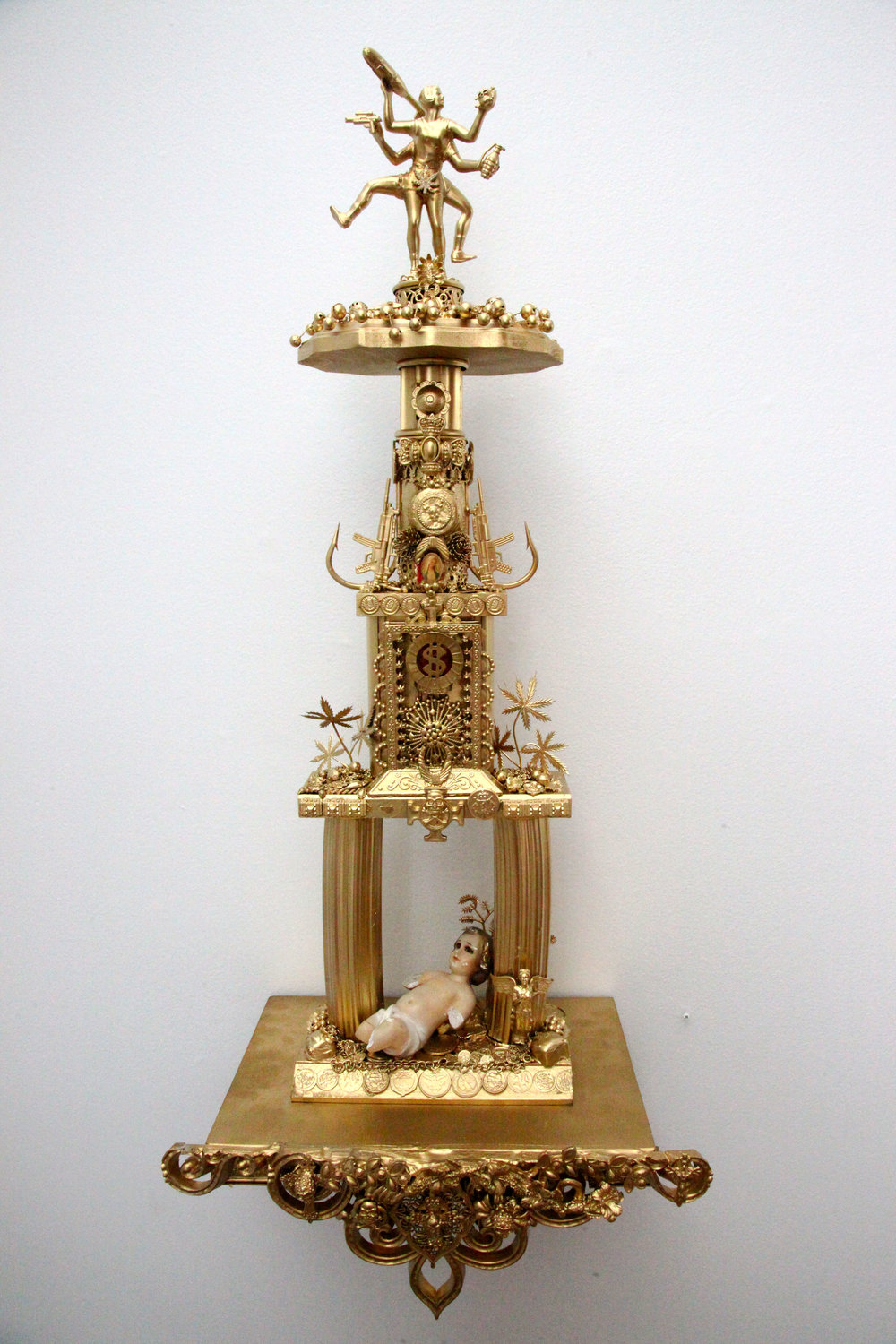 """Trophy #3 -- A Cryptic yet Precise Ritual of Confrontation Between the Designs of Good & Evil""   Mixed media, found objects  28 1/2"" x 7 1/2"" w/o shelf, 33 1/2"" x 14 1/2"" w/shelf  2016"