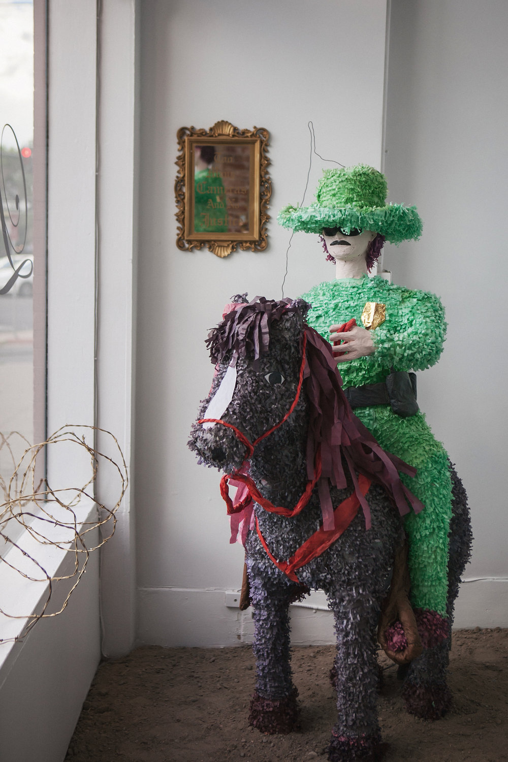 """Western American Posse for the People. A phenomenal Order of Historical yet Dissimilar Expressions of Artistic and Social Considerations.""  Mounted Guard Piñata 71"" x 50"" x 22""  2016"