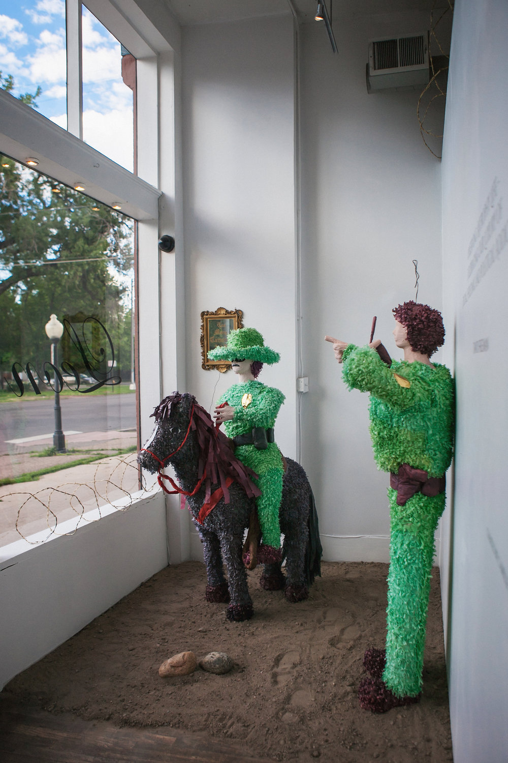 """Western American Posse for the People. A phenomenal Order of Historical yet Dissimilar Expressions of Artistic and Social Considerations.""  Patrol Guard Piñatas 73"" x 22"" (Guards) 71"" x 50"" x 22"" (Mounted Guard)  2016"