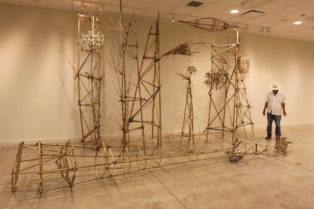 """Bamboo Satellite Towers""  Photograph of installation   Dimensions variable"