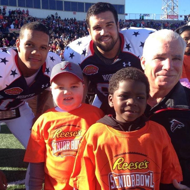 SS Falcons Coach Smith & The U players at Senior Bowl.JPG