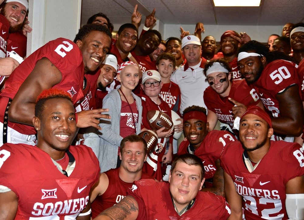 Coach Bob Stoops and Kids Locker Room.jpg