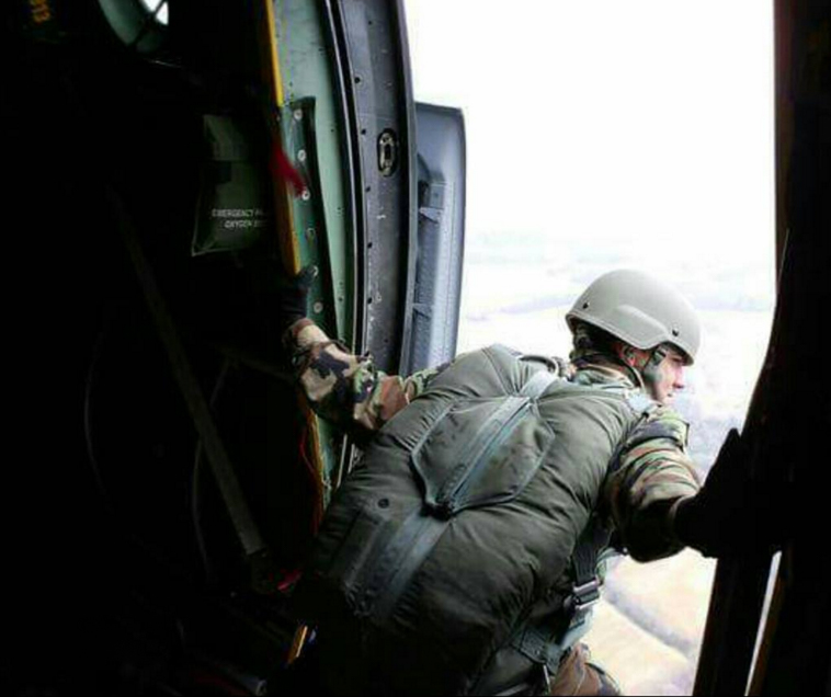 "Garcia performing ""jumpmaster duties,"" on a C-130."
