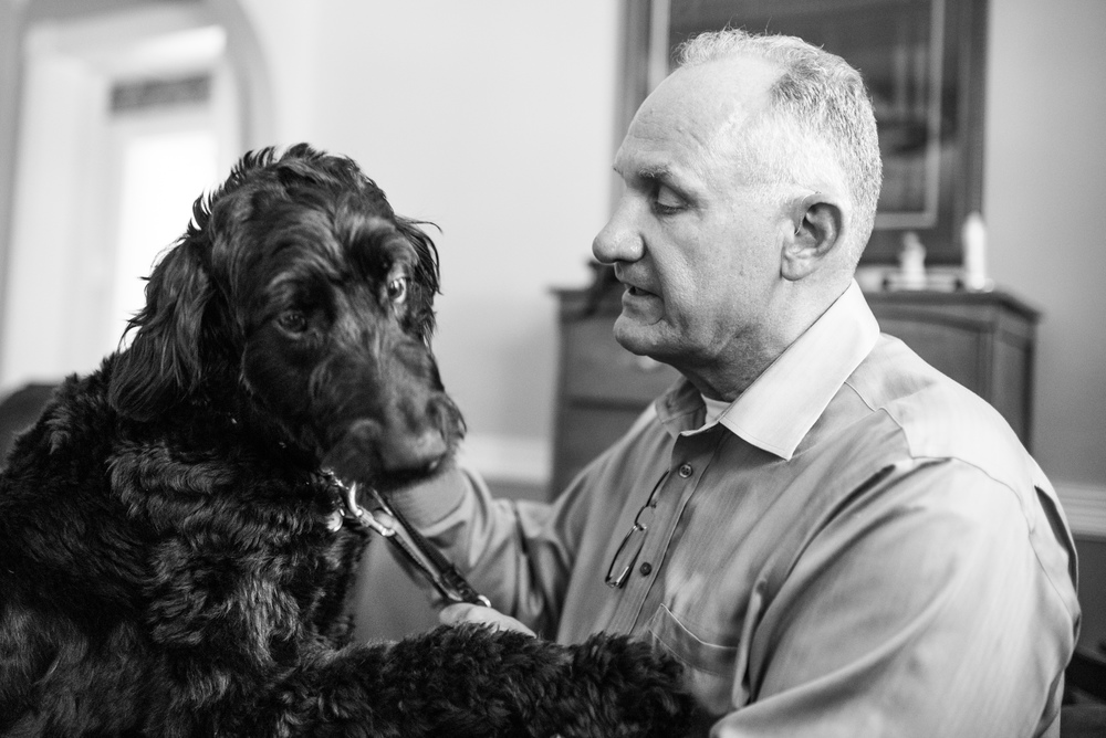Jim with his service dog, a Labradoodle named Sophie.