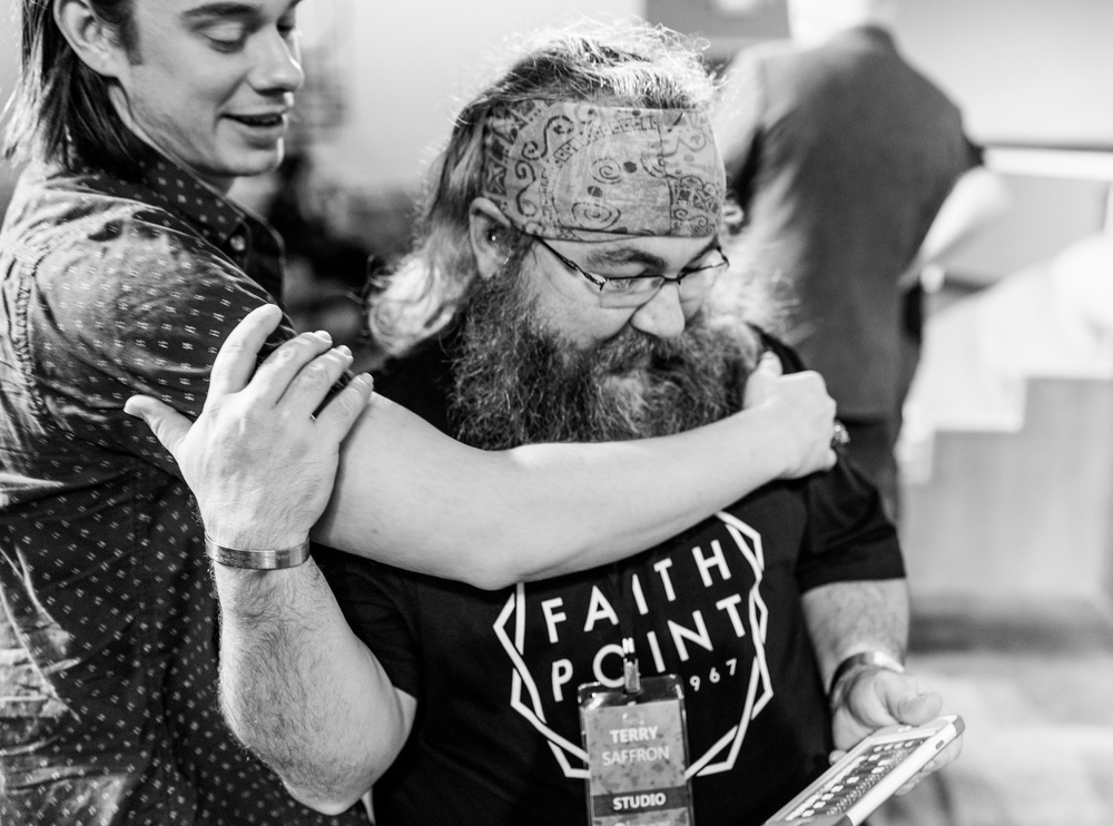 Terry receives a hug from one of his good friends and Worship Leader at Faith Point, Tyler Hoxworth.