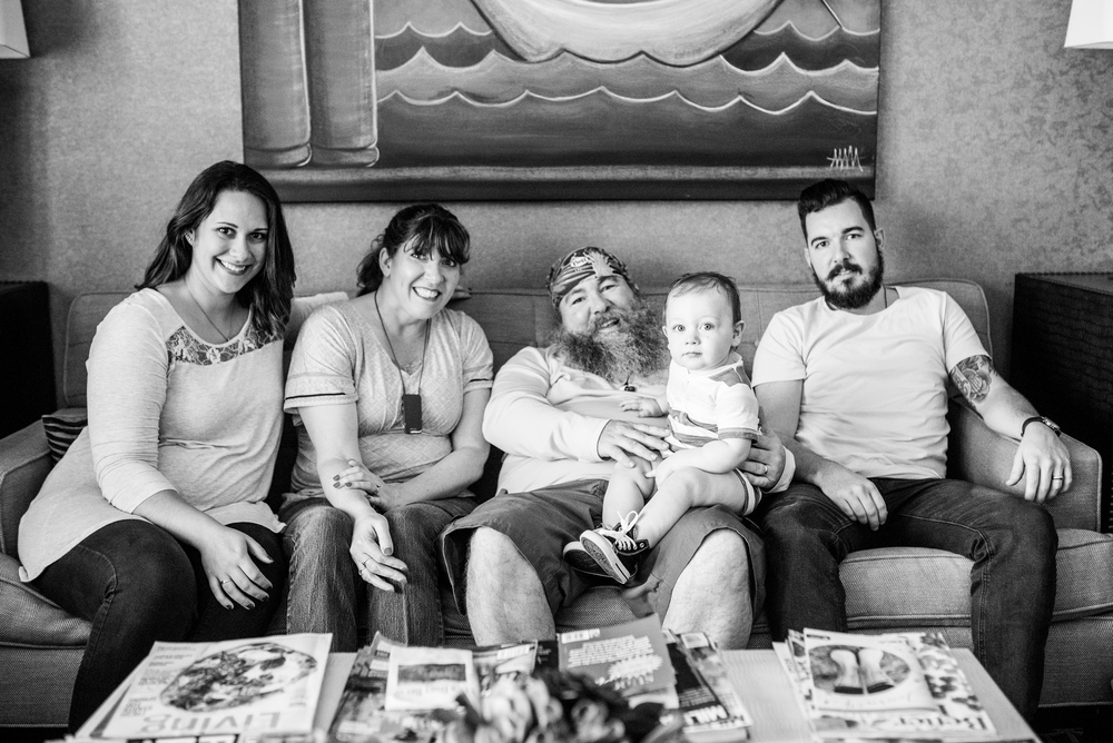 Terry sits with his family who he credits as being the most important part of his life besides God.  From left to right: Daughter-in-law Melissa, wife Colleen, grandson Joshua, and son Josh.
