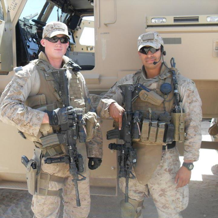 Evan stands (left) with his team leader Corporal Roberto Martinez during in his time in Iraq.