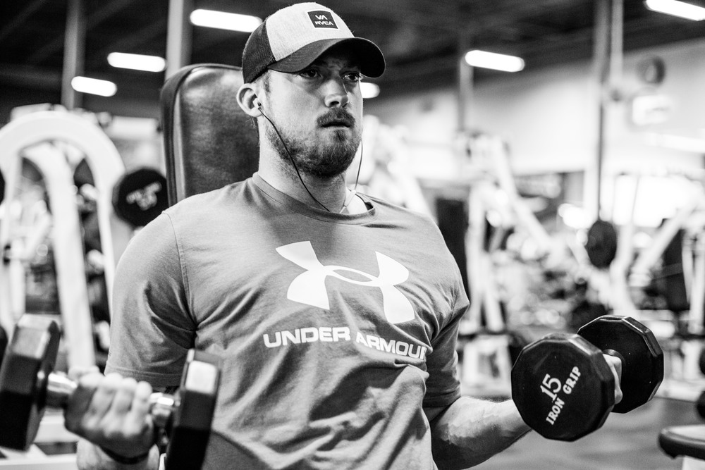 Evan works through a high intensity set of high rep, light weight curls. You can see the brace he wears to support his shoulder.