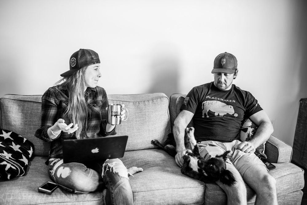 Tyler sits with his girlfriend Jaclyn Renee (Owner of Red's Pantry) and dog, Master Splinter.