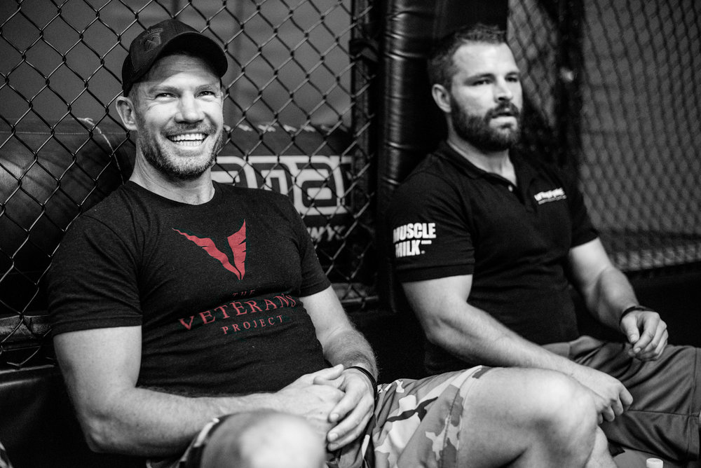 Nate sits with Brett Bartholomew, the head trainer at Unbreakable Performance Center.