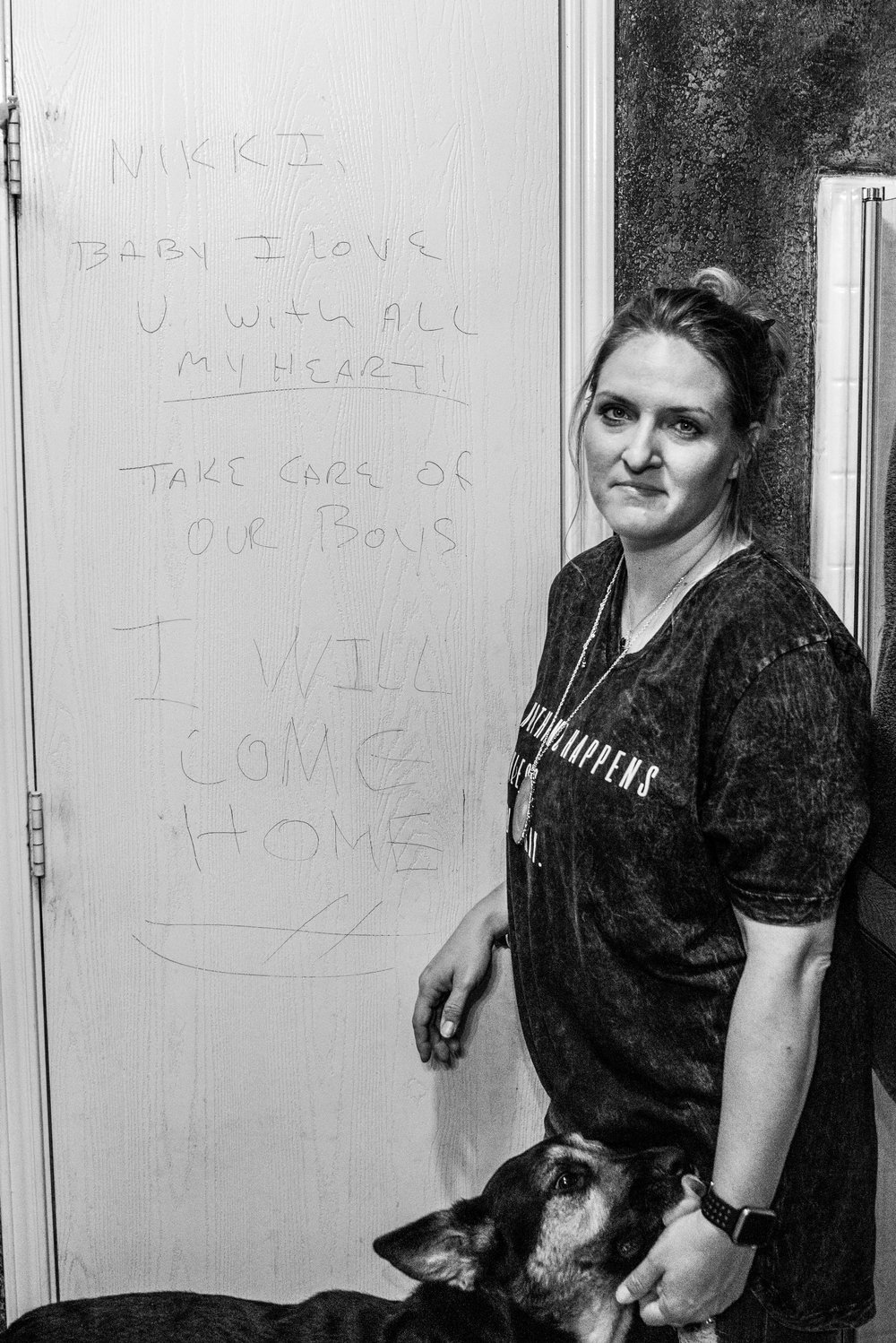 Picture: Nikki stands next to the bathroom door where Carter left her a message before his last deployment to Iraq.