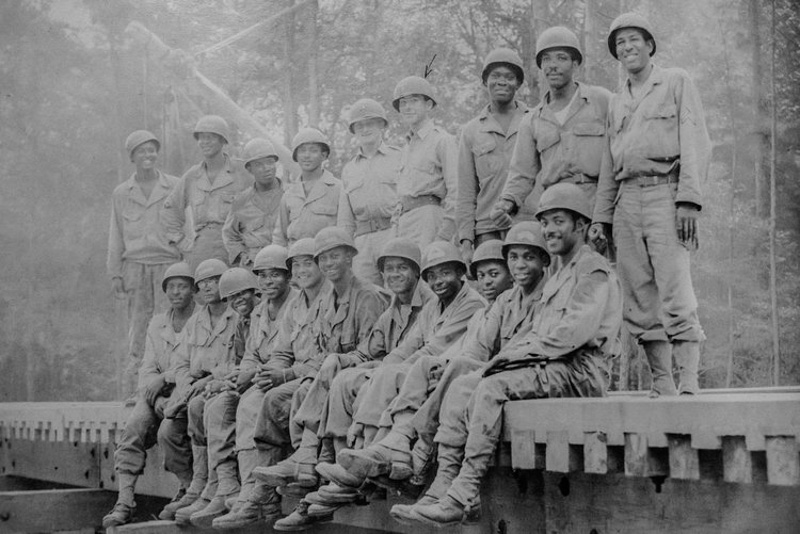 """LT Mendieta with his platoon. The unit was a part of an """"all black regiment."""" Desegregation still hadn't taken place within the Army."""