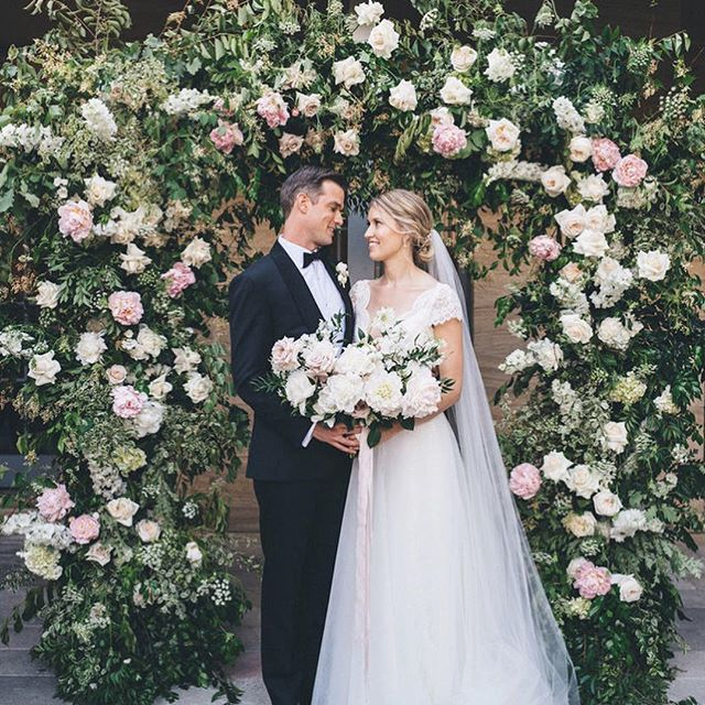 Eliza & Steve's ceremony at the beautiful @gunnersbarracks courtyard was one of our favourites from last year ~ enhancing and not competing with the style & aesthetic of the venue, we created a whimsical garden with a beautiful full lush arch as the major feature for the lovers to be wed! This special moment was captured by the most wonderful photographer @msannmarieyuen | Bride is wearing @kwhbridal | Swipe across   for more of the pretty floral details 💕 xx