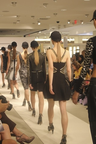 The final walk showcases details in the collection such as embellishments and animal prints.