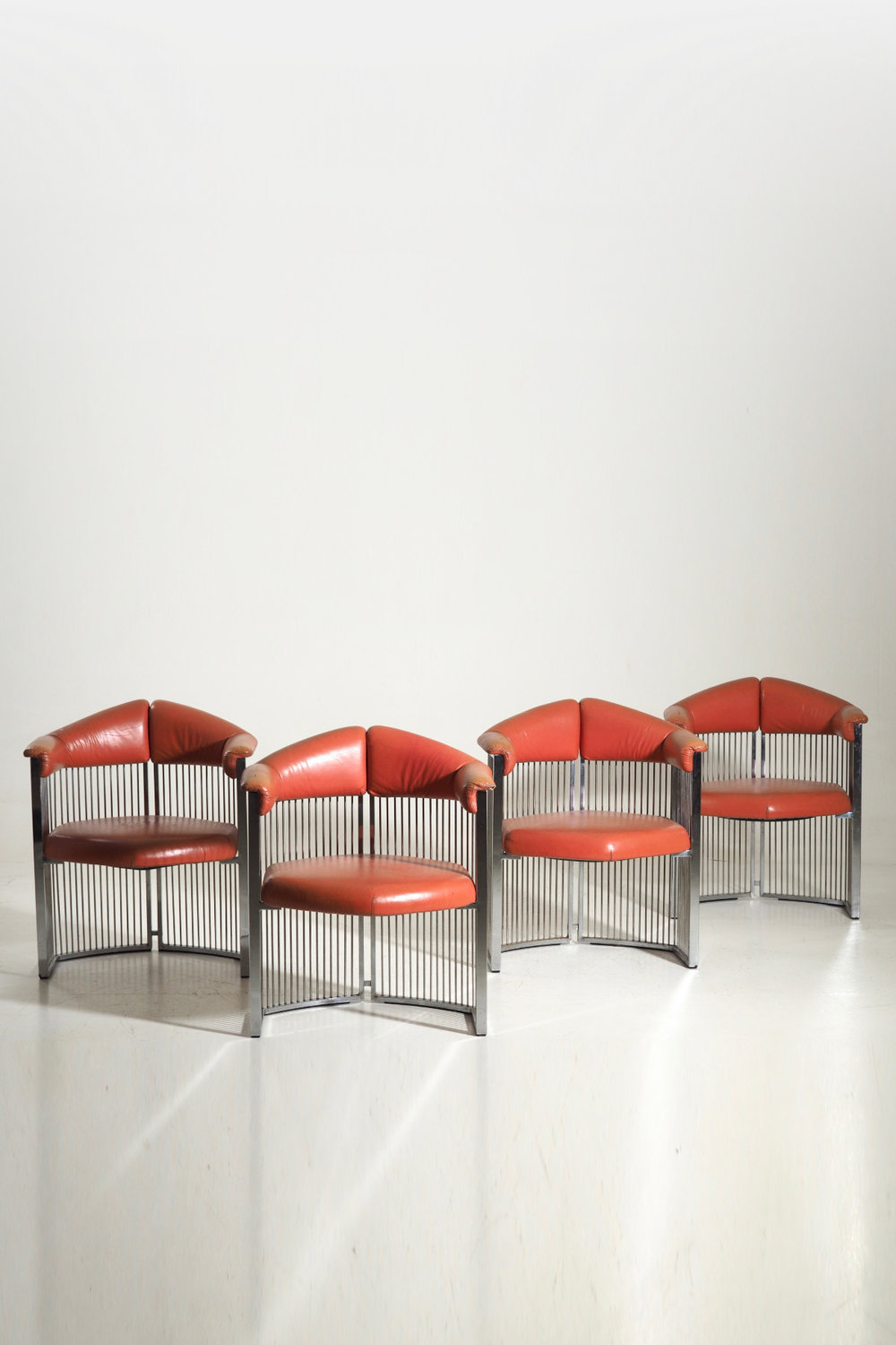 Four Italian armchairs in chromed steel and leather, 60's