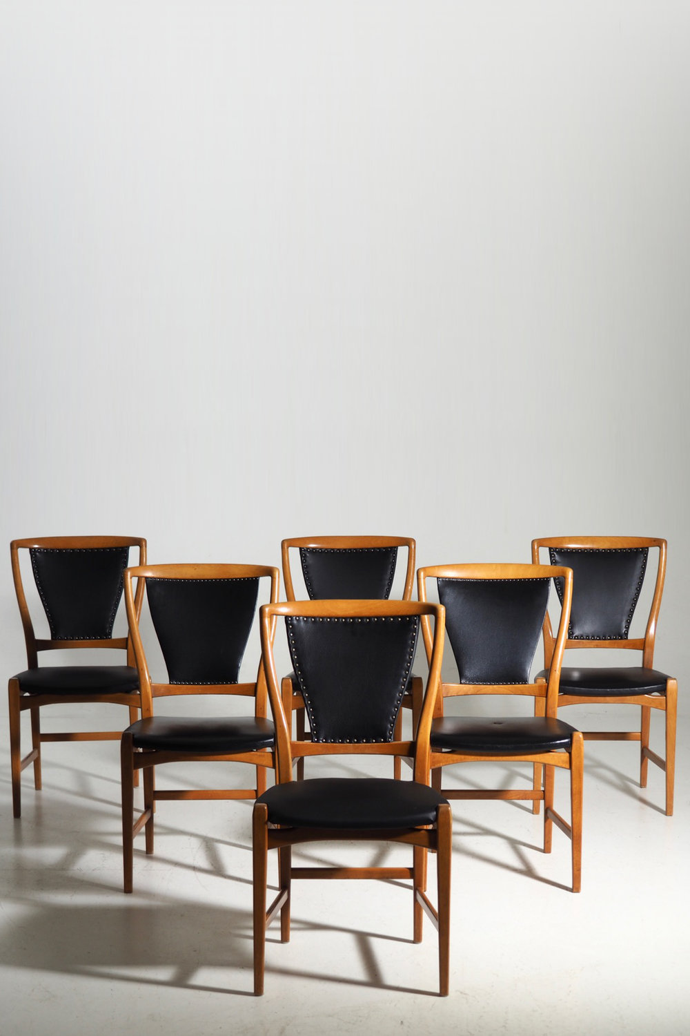 Six chairs in fruitwood and imitation leather, crica 1960 -70´s