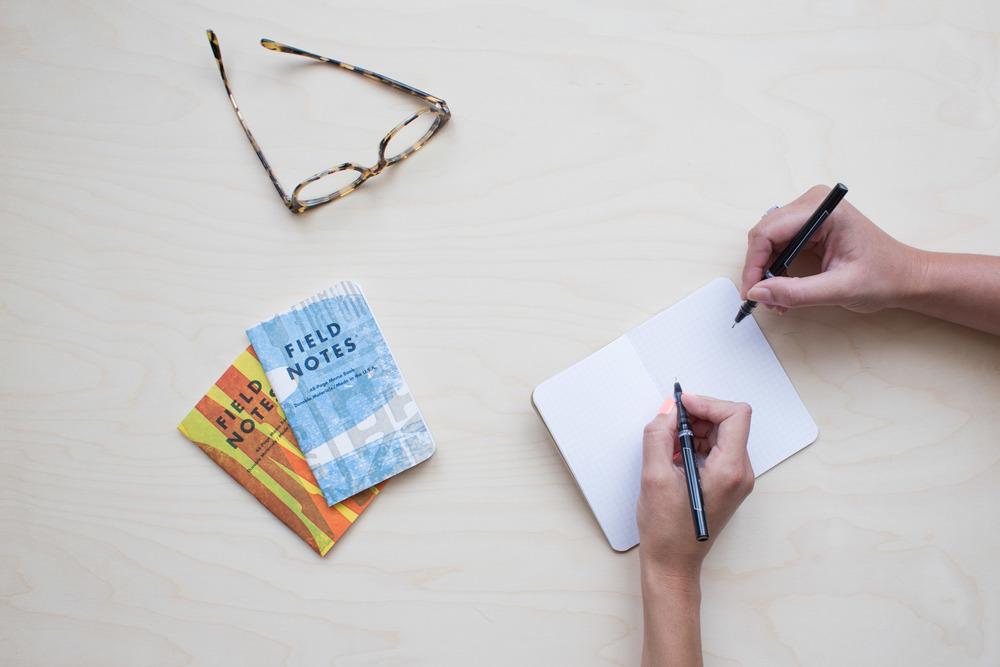 paper glasses pen hands.jpg