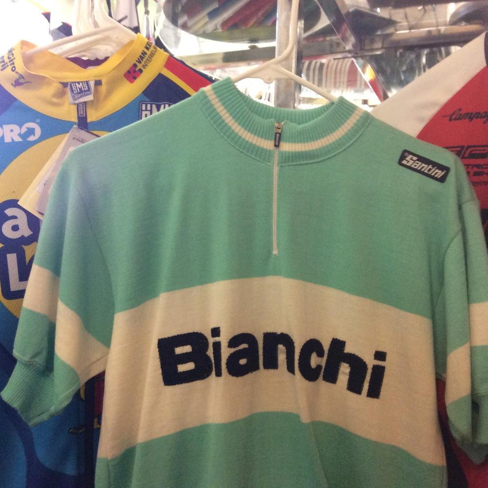 Wool Bianchi short-sleeved bike jersey sits on the backroom rack.