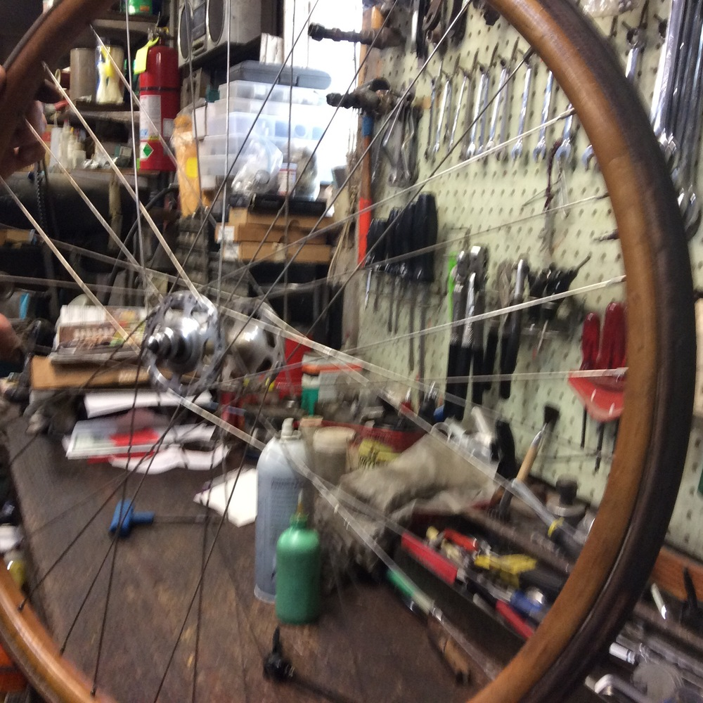A very blurry photo of a wooden wheelset with Campy hubs. According to Mike, these wheels are one piece of steamed wood. He estimated them to be from the 1940's. Too bad it's blurry to confirm if it's a triple-cross spoke pattern.