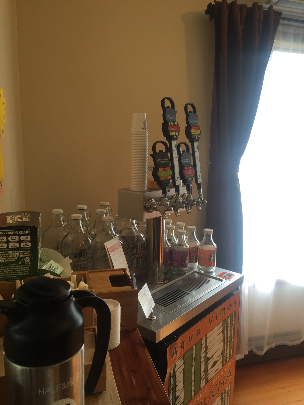 The Kombucha taps (note the growlers behind).
