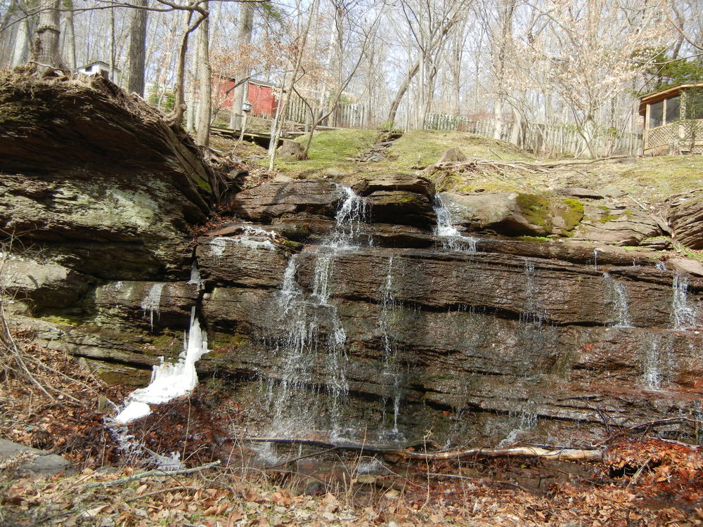 A waterfall that continues on into Smithtown Creek.