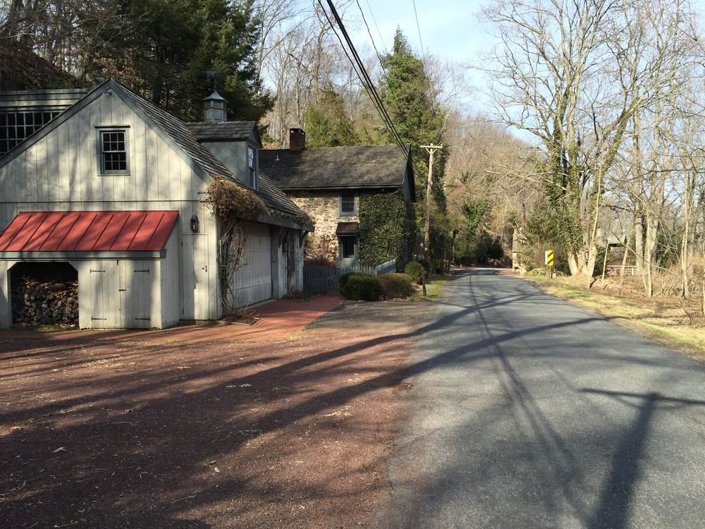 The Fleecydale Cottage. The orange cone in the distance demarcates the start of the difficult Short Road climb. Or one can continue on toward the Delaware River.
