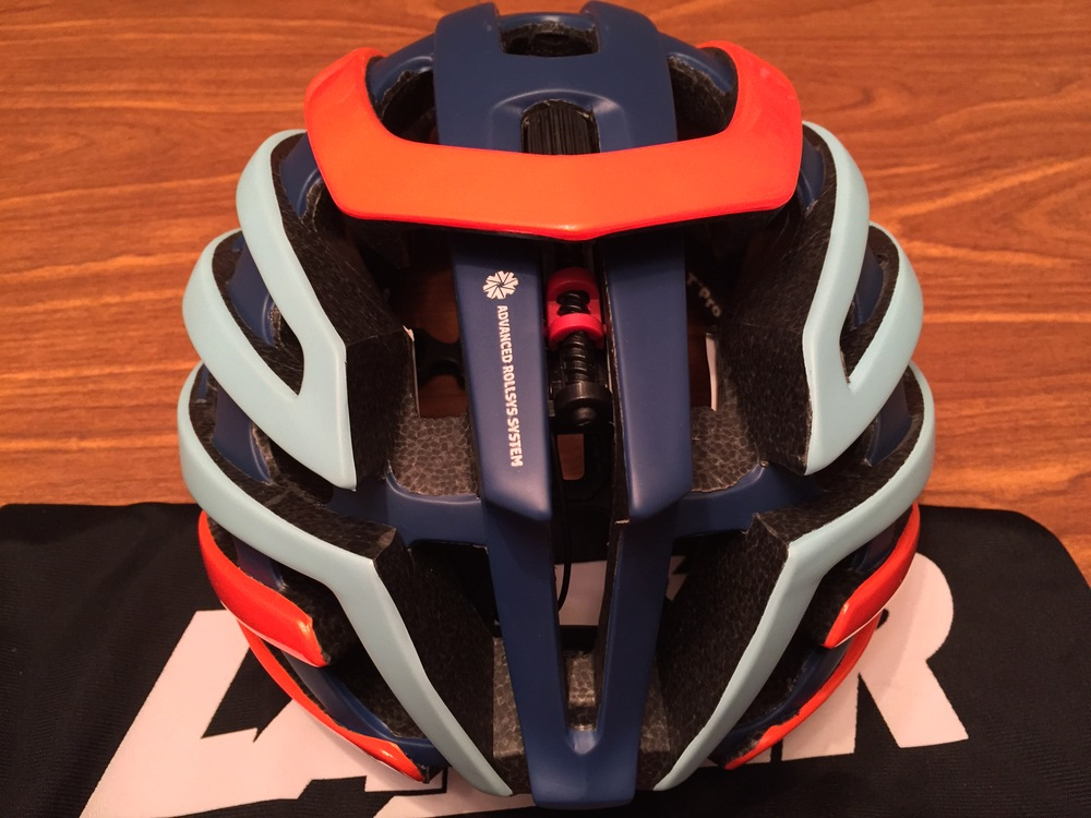 A closeup view of the Advanced Rollsys System. The black thumb wheel ahead of the orange cowling is the adjuster. The black screw is the tensioning system. According to Lazer, by moving the sizing options to the top of the helmet allows for a symmetrical fit as well as appealing to riders who have ponytails.