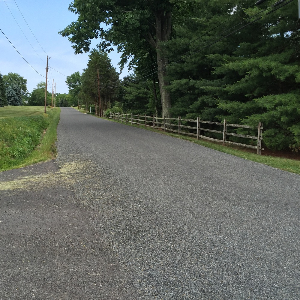 Farm School Road was extremely smooth until recently. To the right of this photo is the continuation of Rolling Hills Road, recently chipped and oiled and in deplorable condition.