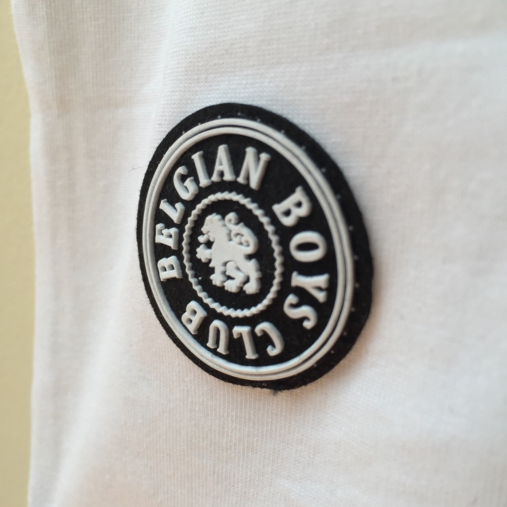 The Belgian Boys Club rubber stamp signifies quality and an attention to detail.