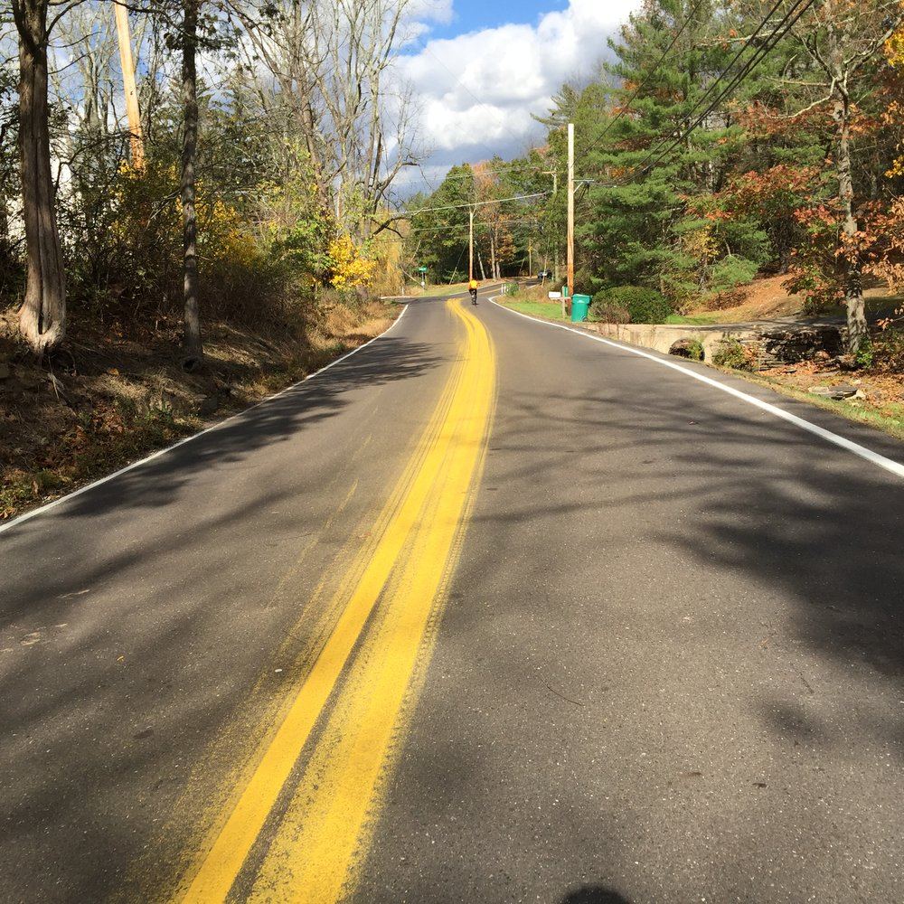 Should a rider, such as the one up the road, find himself on Dark Hollow, please take the entire road's length to admire the wonderful line painting job by  PennDOT . It's absolutely beautiful.