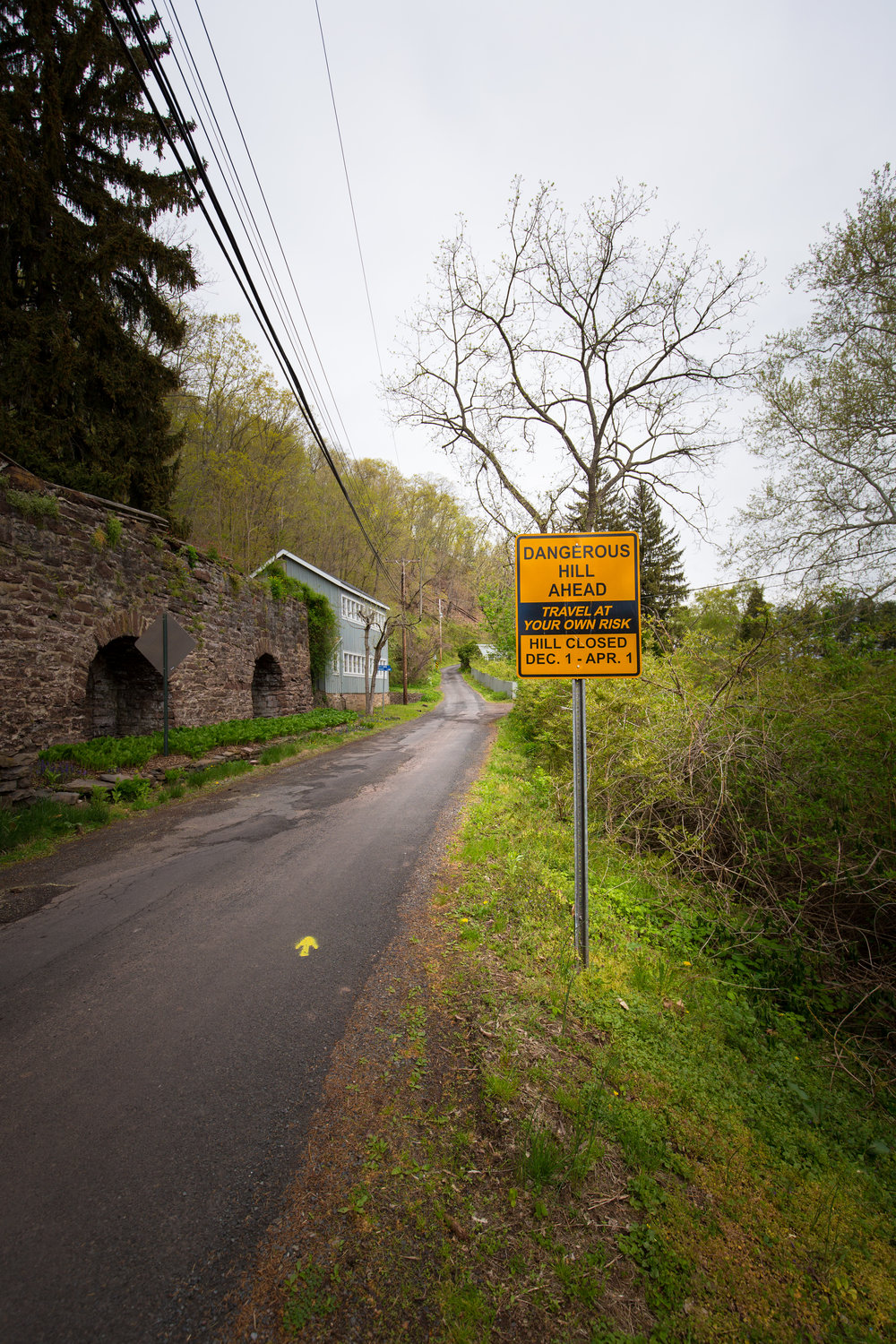 Following the yellow arrow up the notorious Uhlerstown Road, many first-timers to the Fleche Buffoon are unaware as to what's around the corner of this one way seasonal road. Photo by  Mike Maney Photography .