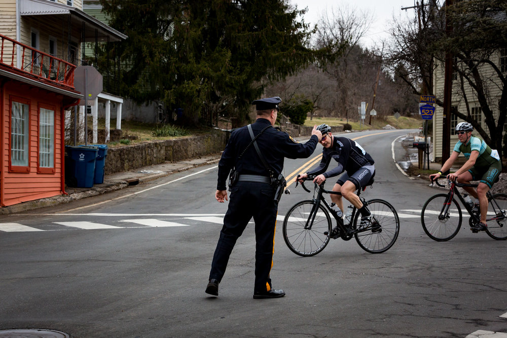 Many intersections allowed safe passage by police presence. Here, a police officer gives priority to cyclists riding in the Hell of Hunterdon as they pass through Sergeantsville, NJ. Photo courtesy Mike Maney.