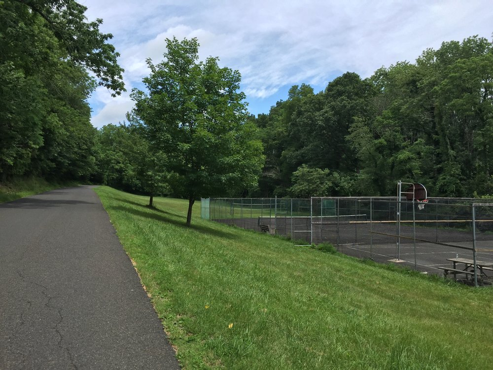 Once crossing Smithtown, this tennis and basketball court can be seen. Never has anyone been observed using any of these courts.
