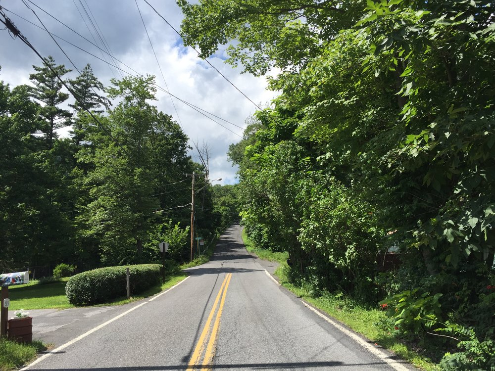 The final moments before the monstrous Devil's Kitchen climb on Platte Cove Road. Turn left and all is forgotten. Stay straight and atonement is achieved through sweat.