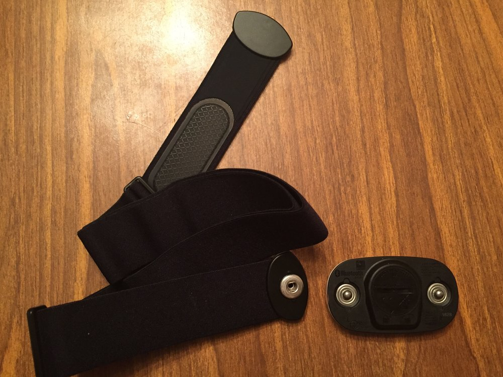 The soft strap has two gripper pads and snaps. The HRM snaps to the strap easily.
