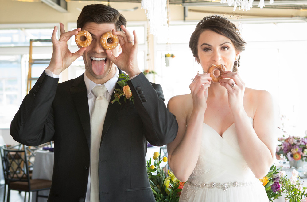 Couple Sean and Melissa at The Big Fake Wedding with our doughnuts. Moment captured by 13 One Photography.