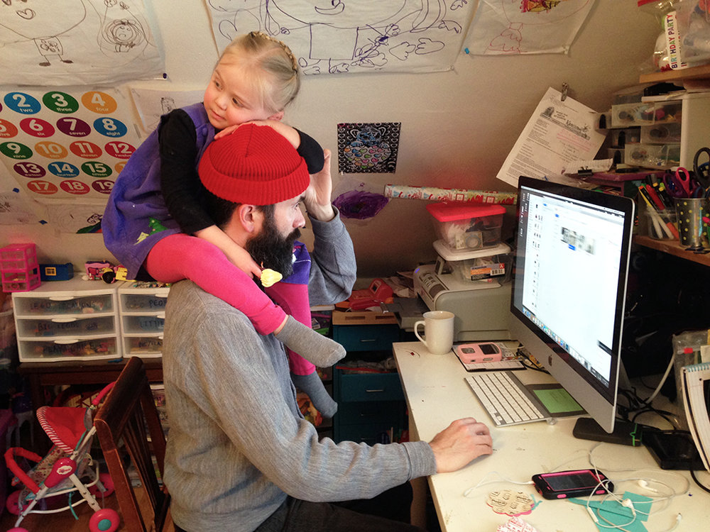 My husband Blade managing to work at the computer with our daughter on his shoulders