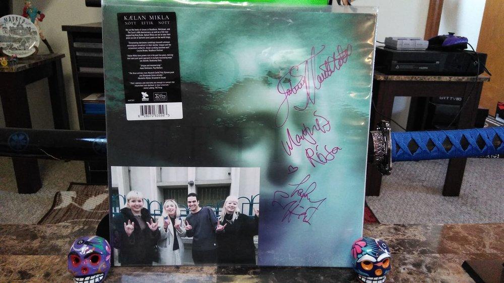 signed vinyl in living room.jpg