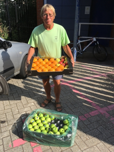 Tim Head from Stamshaw adventure playground collecting fruit for the Holiday Hunger campaign.jpg