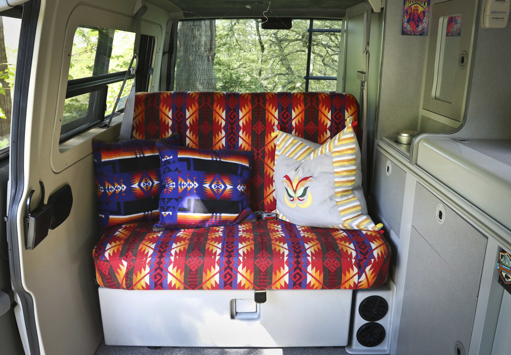 The rear bench was reupholstered in the Coyote Butte pattern from Pendleton Woolen mills.     The fabric was bought by the yard at The Woolen Mills Store in Portland, Oregon.   The re-upholstery was done by Hoglunds in Everett, Washington.